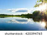 Shinny sun reflected in the lake, Finland. - stock photo