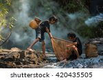 Stock photo children poverty living in countryside vietnam are fishing at the river 420435505