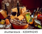 cheese and wine on a dark table....   Shutterstock . vector #420494245