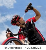cyclist refreshes from a bottle ... | Shutterstock . vector #420528226