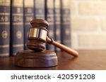 Gavel Leaning Against A Row Of...