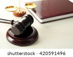 gavel with book and scales on