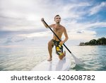 young man stand up on paddle... | Shutterstock . vector #420608782
