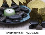 Spa Stones And Candle In A Bowl