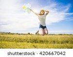 happy young caucasian girl is...   Shutterstock . vector #420667042