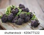purple broccoli sprouts on... | Shutterstock . vector #420677122