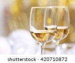 wineglasses on blurred... | Shutterstock . vector #420710872
