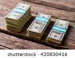 dollar bundles on wooden...