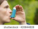Asthma Patient Inhaling...