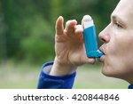 Small photo of Asthma patient inhaling medication for treating shortness of breath and wheezing. Chronic disease control, allergy induced asthma remedy and chronic pulmonary disease concept.