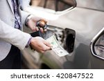 businessman puts dollars into... | Shutterstock . vector #420847522