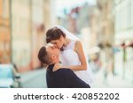 happy bride and groom on their... | Shutterstock . vector #420852202