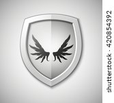 design shield with wings inside.... | Shutterstock .eps vector #420854392