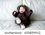 Asian Newborn Baby Wearing Bea...
