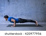 young man practicing yoga.... | Shutterstock . vector #420977956