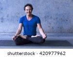 mexican yoga teacher meditating | Shutterstock . vector #420977962