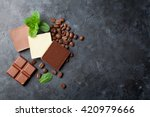 chocolate and coffee beans on... | Shutterstock . vector #420979666