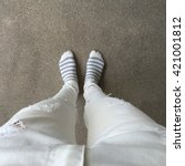 A Pair Of Feet Wearing Brightl...