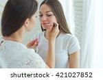 make up artist doing... | Shutterstock . vector #421027852