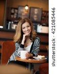 beautiful young woman sitting... | Shutterstock . vector #421085446