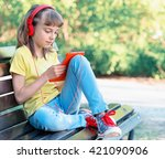 Little Girl With Tablet Pc And...