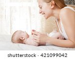 mother with baby at home.... | Shutterstock . vector #421099042