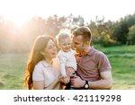 happy family walking outdoor....   Shutterstock . vector #421119298