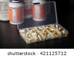 supplements into daily pill box ... | Shutterstock . vector #421125712