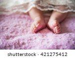 little girls legs under white... | Shutterstock . vector #421275412