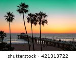 palm trees and pier at sunset... | Shutterstock . vector #421313722