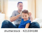 father combing hair of his... | Shutterstock . vector #421334188
