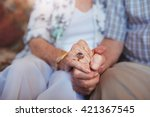 cropped shot of elderly couple... | Shutterstock . vector #421367545