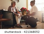 senior woman sitting on a chair ... | Shutterstock . vector #421368052