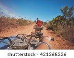 young man driving a quad bike... | Shutterstock . vector #421368226