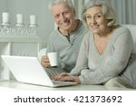 happy senior couple with laptop | Shutterstock . vector #421373692