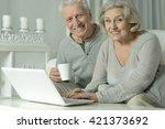 happy senior couple with laptop | Shutterstock . vector #421373692