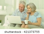 happy senior couple with laptop | Shutterstock . vector #421373755