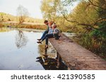 happy family spending time together outdoor. Lifestyle capture, rural cozy scene. Father, mother and son walking in forest