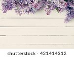 Lilac Flowers On Vintage Woode...