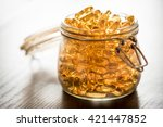 omega 3 6 9 fish oil yellow... | Shutterstock . vector #421447852
