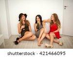 three beautiful girls getting... | Shutterstock . vector #421466095