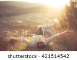 carefree happy woman lying on... | Shutterstock . vector #421514542