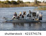 Small photo of USA - February 13, 2016: Tourist enjoying and airboat ecotour of the Sawgrass Recreation Park in the National Everglades Park near Weston, Florida on February 13, 2016.
