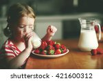 happy child girl drinks milk... | Shutterstock . vector #421600312