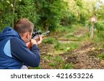 Small photo of Young man shoot with air rifle.