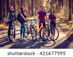 four smiling adults with... | Shutterstock . vector #421677595