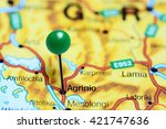 Small photo of Agrinio pinned on a map of Greece