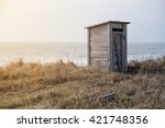 Wooden Toilet On The Beach