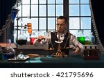 the man   chemist  weighing on... | Shutterstock . vector #421795696