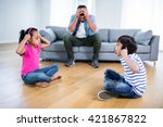 annoyed father sitting on sofa... | Shutterstock . vector #421867822